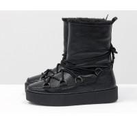 Зимние высокие ботиночки Луноходы в стиле Moon Boot из натуральной кожи флотар черного цвета, на прорезиненной утолщенной подошве, Коллекция Осень-Зима , Б-17112-04